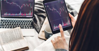 Woman checking the Australian stock market news and graph